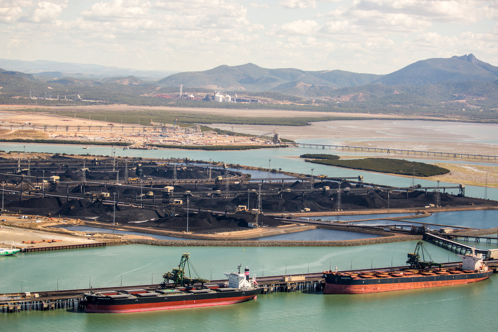 Large export vessels are loaded with coal and other cargo at the Gladstone Port. Queensland, Australia.