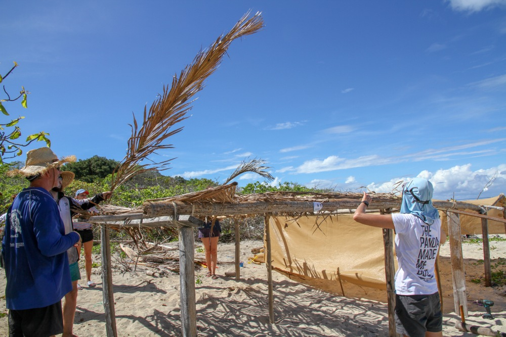 Research scientists working on a palm frond shade construction © Veronica Joseph / WWF-Aus