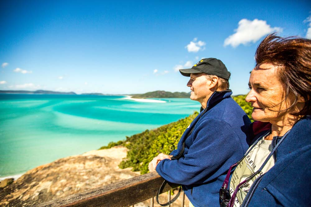 Tony and Beverly Fontes look out over Whitehaven Beach © WWF / James Morgan