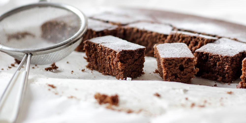 Brownies on baking paper. Photo by NordWood Themes on Unsplash