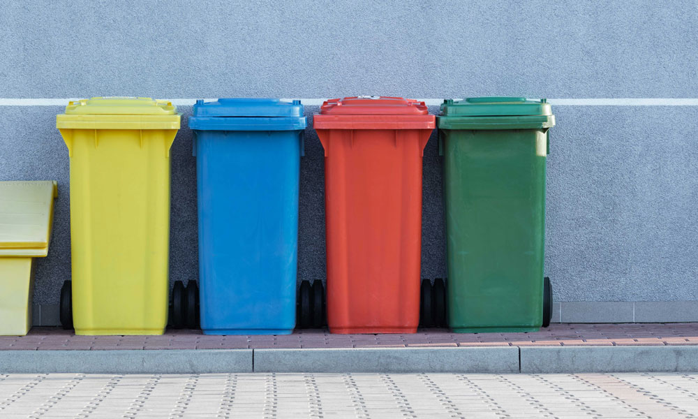 Colourful recycling bins. Photo by Paweł Czerwiński on Unsplash