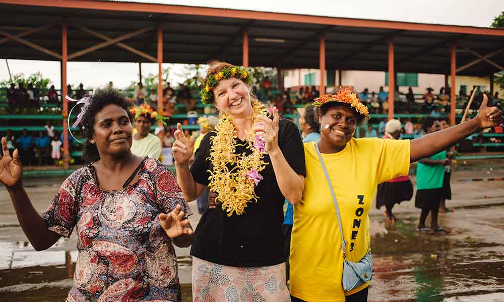 Gilly Llewellyn WWF-Australia conservation director dancing at the end of the Women's Saving Club launching celebration, Solomon Islands, 2015 © Arlene Bax / Simplot Australia / WWF-Aus