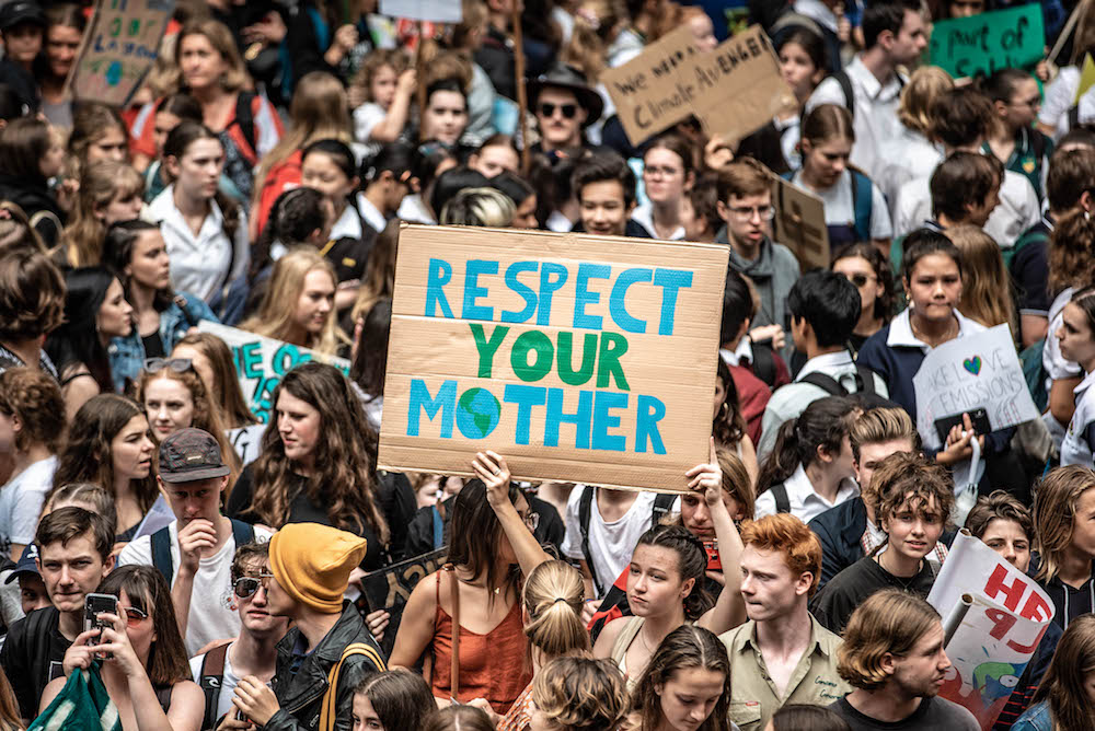 A sign stands out in the crowd taking part in the Global Climate March in Sydney
