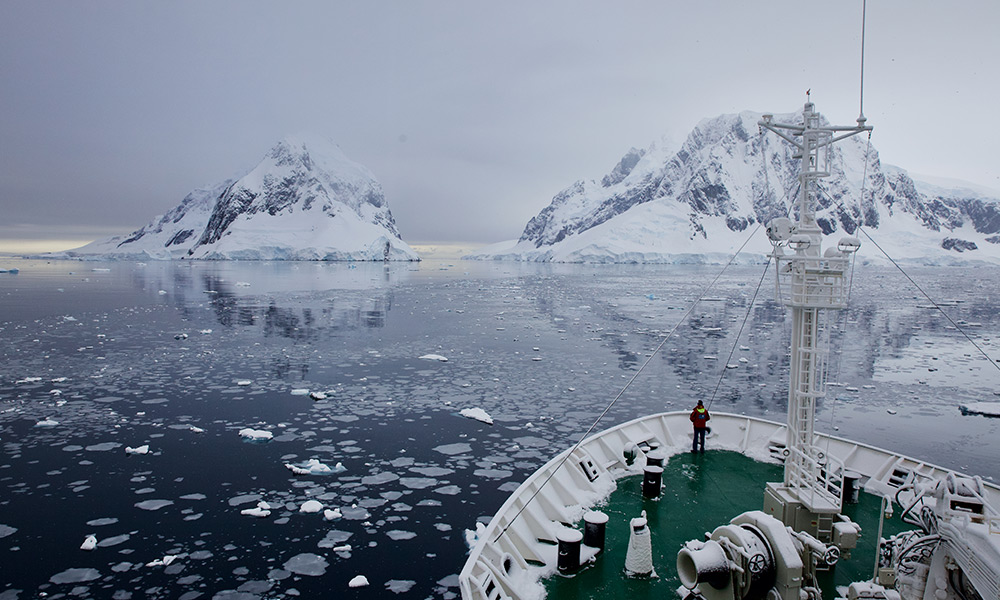 The research ship Akademik Ioffe making its way towards the Lemaire Channel, Antarctic Peninsula © WWF-Aus / Chris Johnson