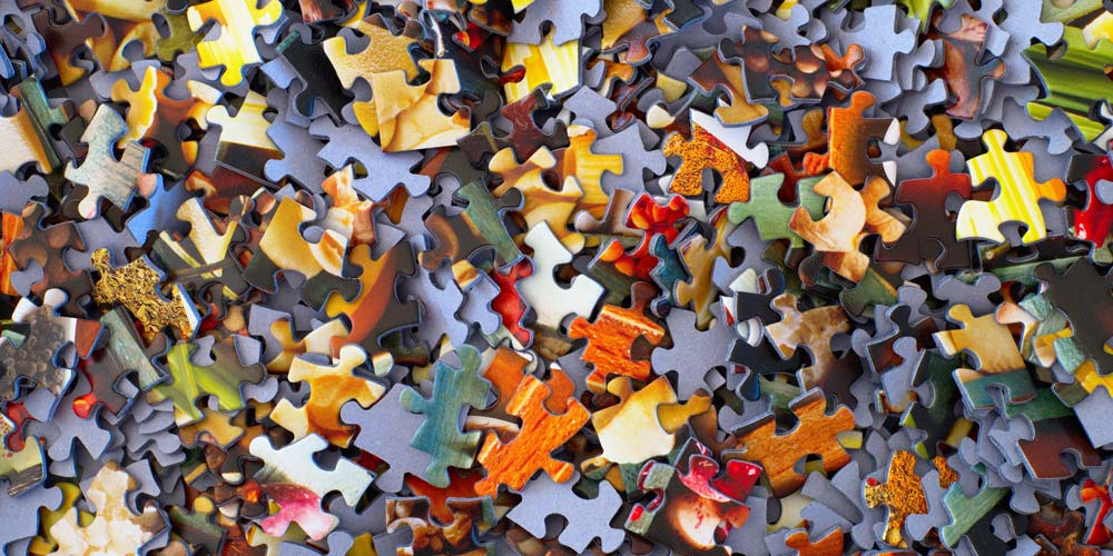 Jigsaw puzzle pieces. Photo by Hans-Peter Gauster on Unsplash