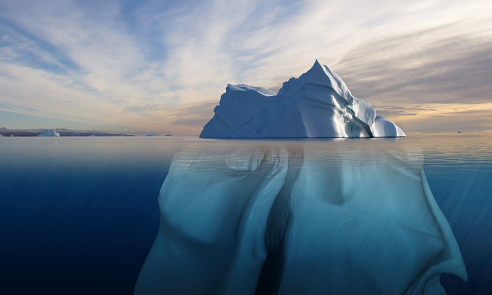 Melting iceberg showing the portion underwater that is sculpted by the sea. Polar regions. Digital composite © naturepl.com / Bryan and Cherry Alexander / WWF