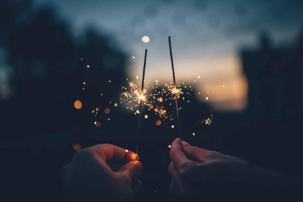 New years sparklers by Ian Schneider on Unsplash
