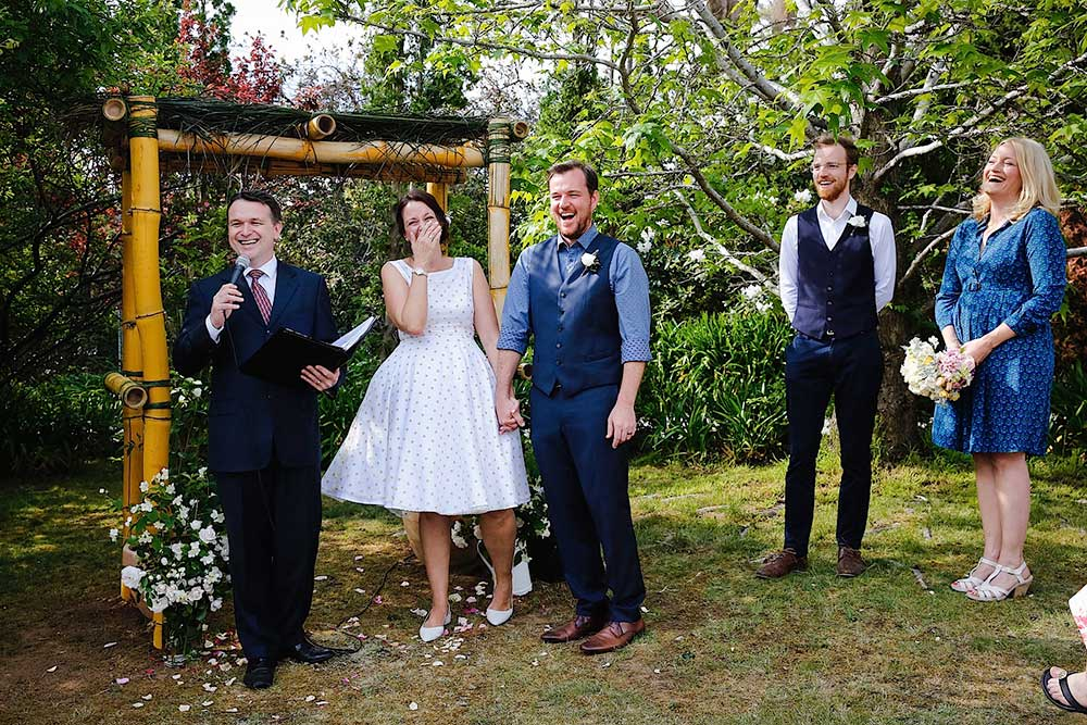 Nat & Reece under their sustainable wedding arch made from bamboo © Anna Blackman