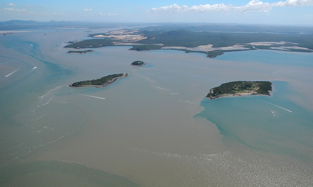 Sediment plumes from dredging associated with the further development of the harbour. Gladstone Harbour, Queensland © WWF-Australia