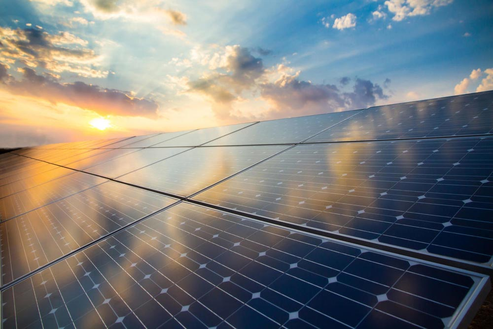 Solar panel with sunset background © Shutterstock / foxbat / WWF