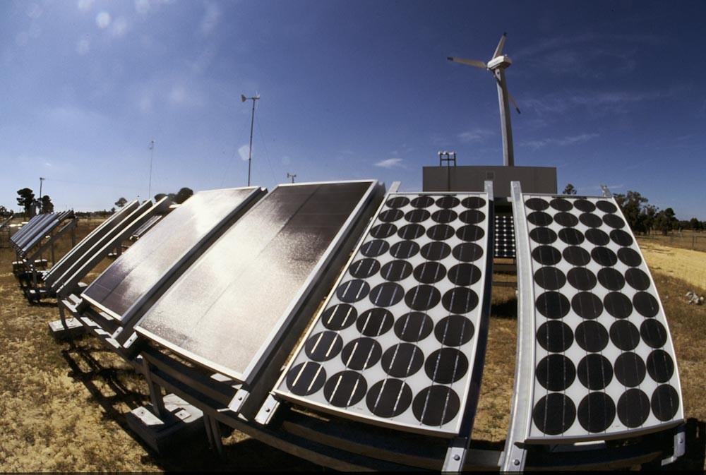 Solar panels and wind turbines at a renewable energy research station in Perth, Western Australia © Richard McLellan / WWF