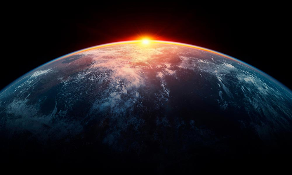 Sunlight eclipsing planet Earth © Bjorn Holland / Getty Images / WWF
