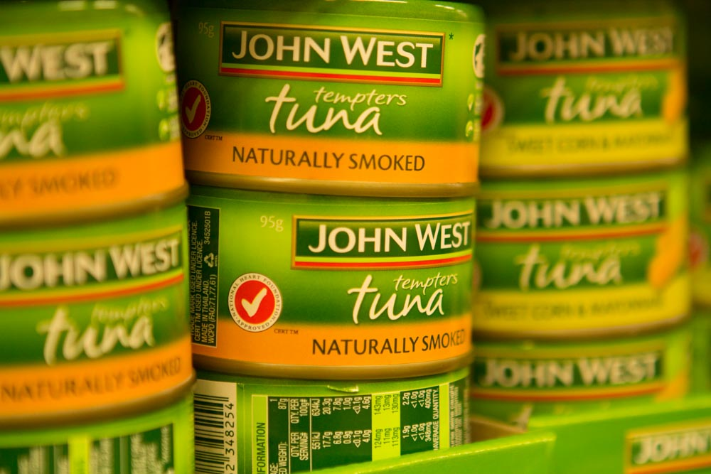 Labelled and certified tuna cans displayed in Coles, Cairns, April 2014© Phil Dickie / WWF International
