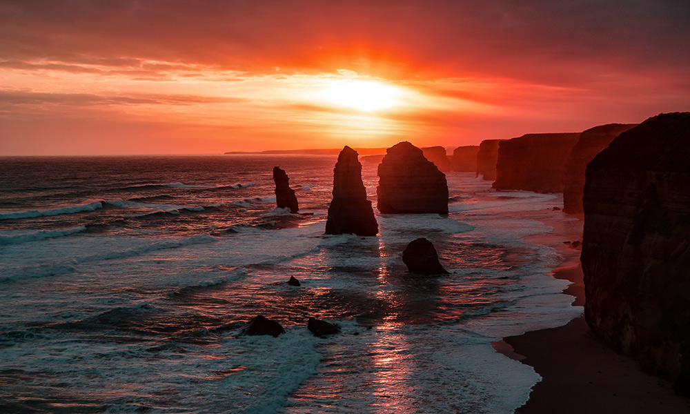 Twelve Apostles at sunset, Australia by Graham Holtshausen / Unsplash
