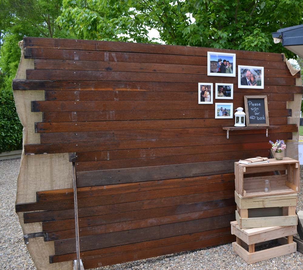 Recycled timber turned into feature wall for sustainable wedding © Reece Proudfoot