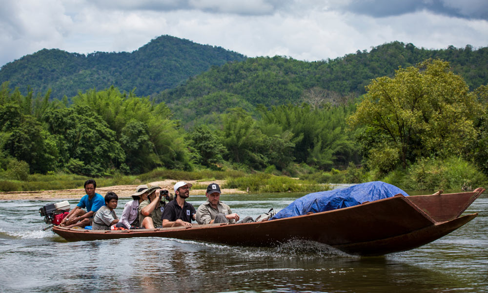 WWF staff riding down the Tanintharyi River, Myanmar, before collecting samples from the river for DNA testing © Hkun Lat / WWF-Aus